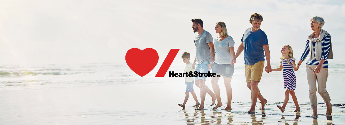 Image of family walking on beach with Heart and Stroke Logo