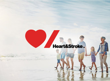 Family walking on a beach with Heart and Stroke Logo overlay