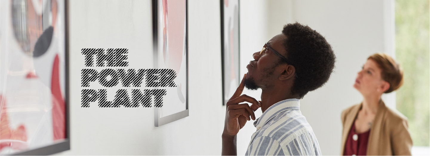 two-people-looking-at-art-gallery-wall-with power-plant-logo