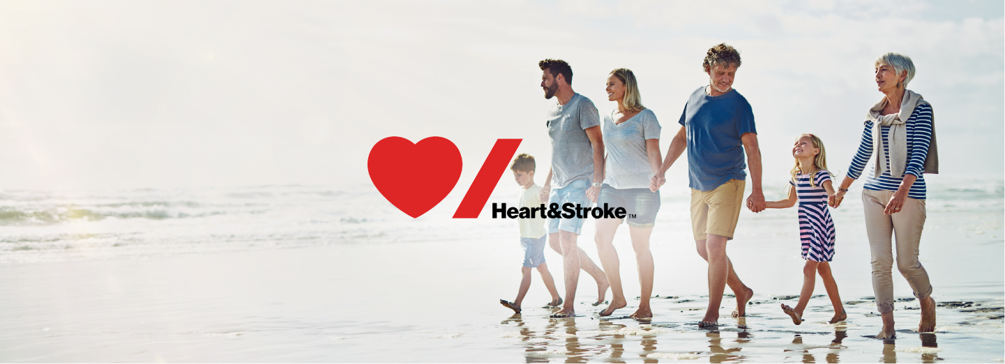 A family walking on a beach with Heart and Stroke Logo overlay