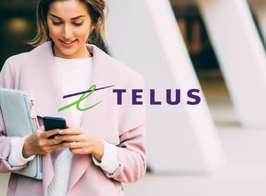 Professional woman texting on her smartphone with Telus logo