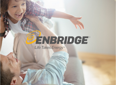 Man lying on couch while holding son in the air