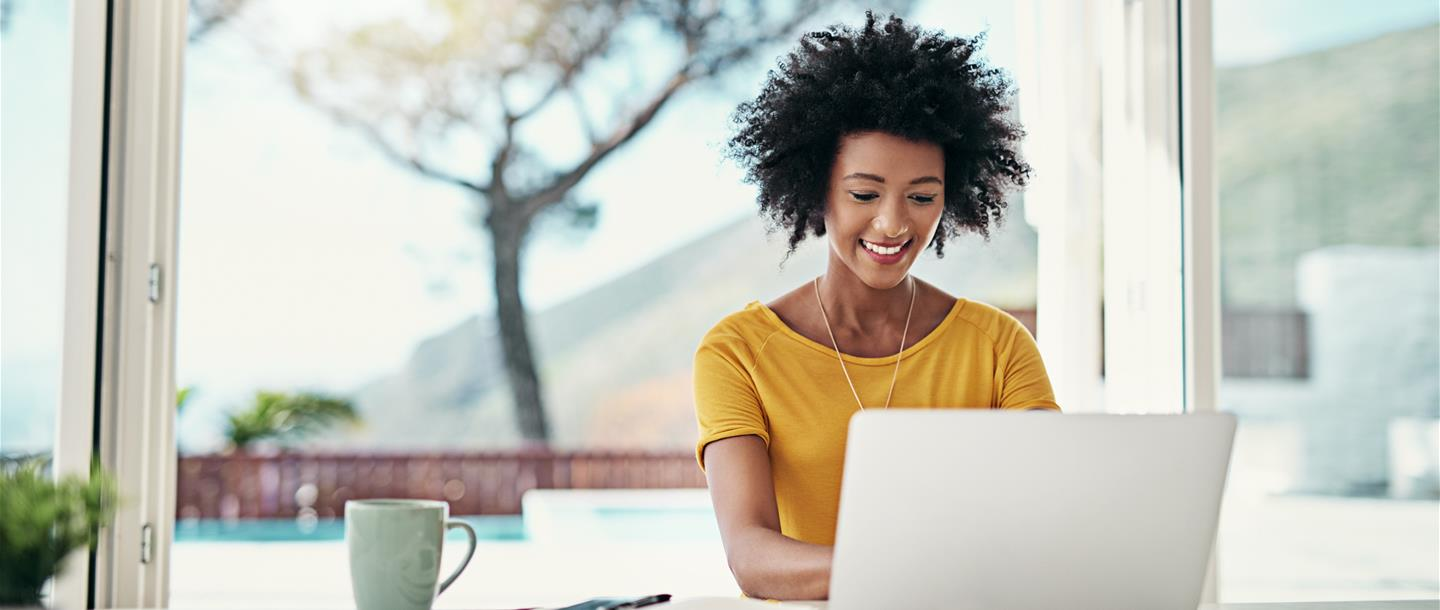 Woman sitting in the comfort of her own home shopping online
