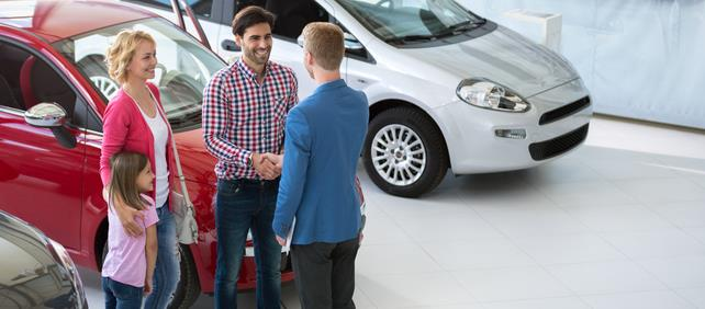 Family buying car at dealership