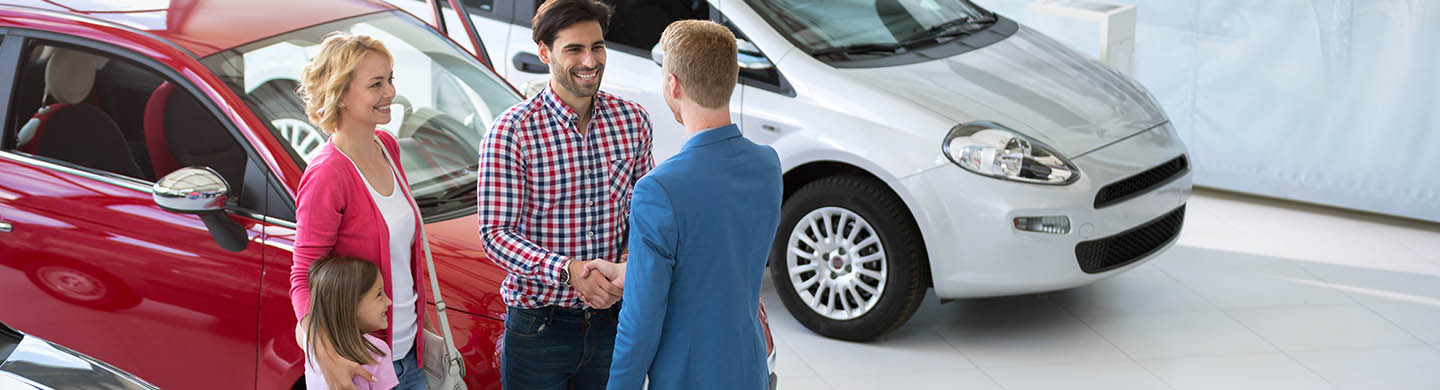 Automotive sales professional greeting customers