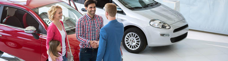 Automotive sales professional greeting customers