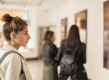 Millennial woman collecting art