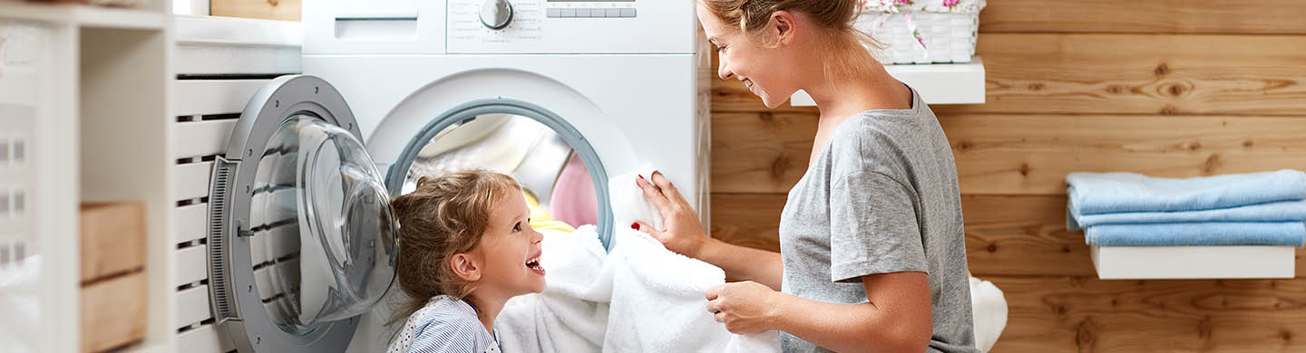 Homeowner using energy efficient laundry appliances