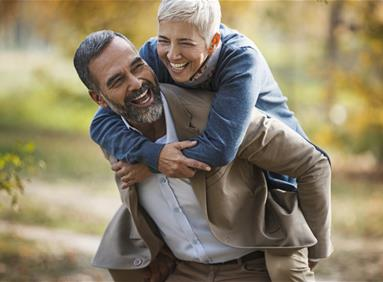Older couple enjoying their retirement together due to prudent financial planning
