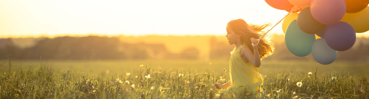 Young girl feeling joyful and running through a field without a care