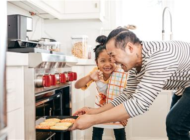 Asian man and daughter baking with groceries purchased online