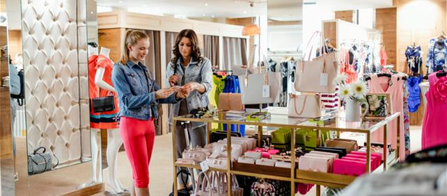 Two women shopping in upscale store
