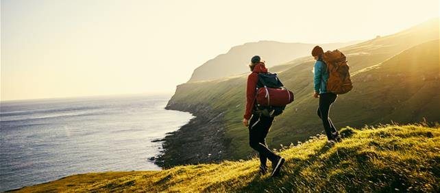 Millennial couple hiking in vacation destination
