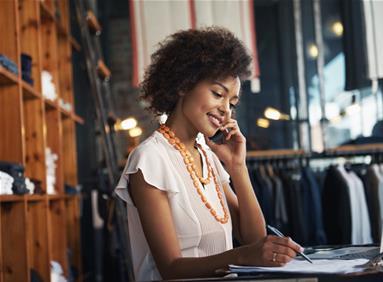 Retail store clerk helping customer online