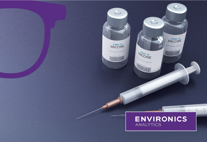 Branded photo of COVID-19 vaccine vials and needle